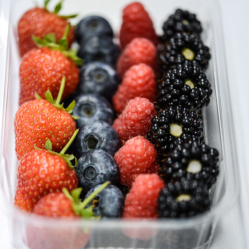 A punnet of strawberries, raspberries, blueberries and blackberries all grown by the The Summer Berry Company